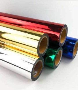 cinco rolos de filme de impressão hot stamping cores sortidas empilhados