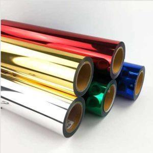 cinco rolos de fita hot stamping em cores sortidas empilhados